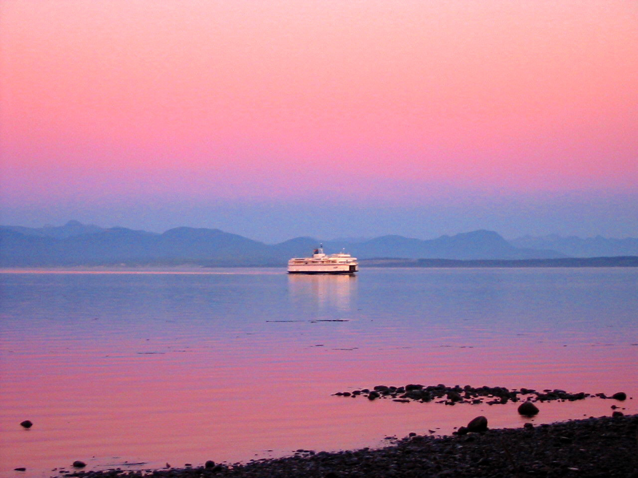 ferry arrives at sunset